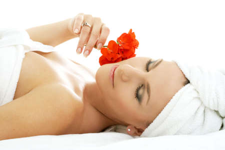 beautiful lady with red flower in spa salon Stock Photo - 540118