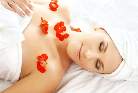 beautiful lady with red flower in spa Stock Photo - 540122