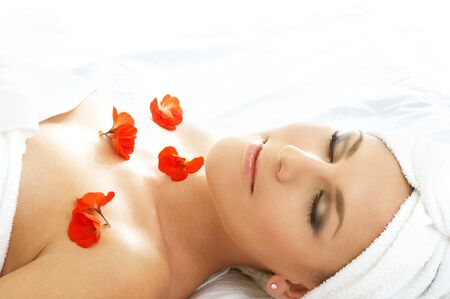 beautiful lady with red flowers in spa Stock Photo - 540121