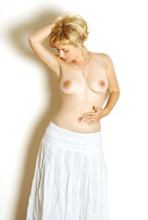 tetas: cl�sica imagen de la chica en topless falda blanca  Foto de archivo