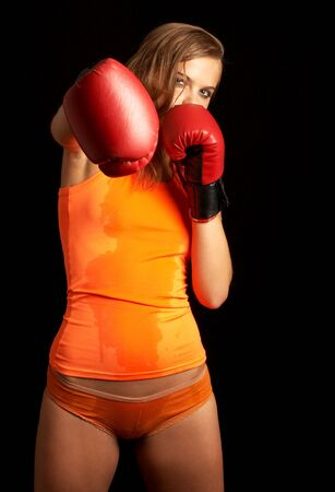 sporty girl in boxing gloves punching photo