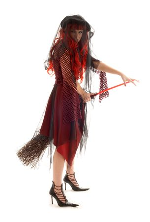 coven: evil halloween witch with a broom Stock Photo