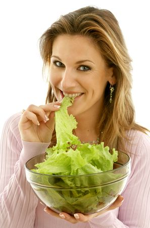 attractive caucasian woman eating lettuce Stock Photo - 547027