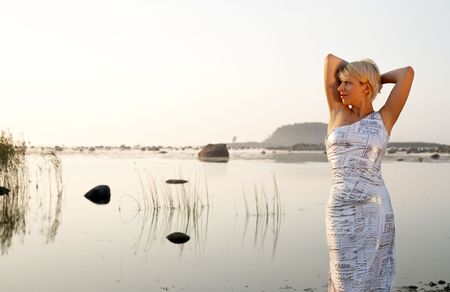 vivifying: pretty blond in fancy dress at the seashore