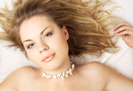 lovely topless girl with shell beads on her neck Stock Photo - 553142