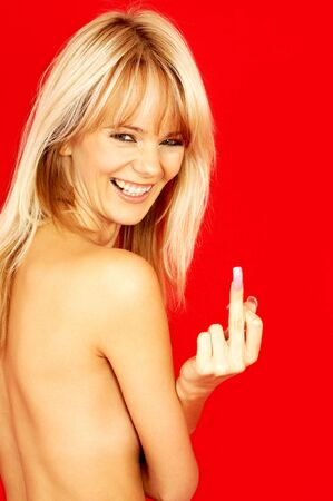 laughing topless blond showing her middle finger Stock Photo - 553133