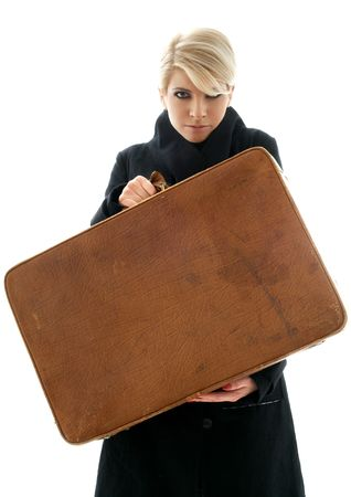 aggressive blond showing big brown suitcase over white background photo