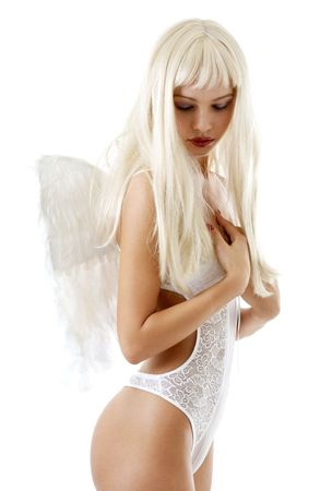 Blond hair girl in white lingerie with angel wings photo