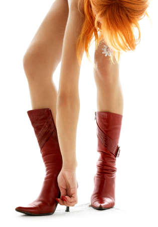 redhead lady hooking her boot up Stock Photo - 571740