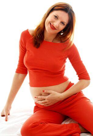 life giving birth: Imagen de la encantadora se�ora embarazada en vestido rojo  Foto de archivo