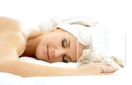 beautiful lady in spa salon with sea shells in glass cube Stock Photo - 587381
