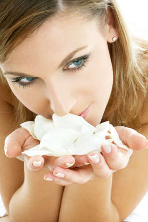 lovely woman in spa smelling white rose petals Stock Photo - 587382
