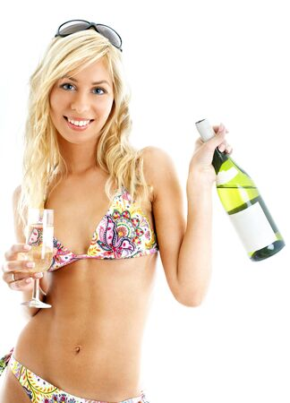lovely blond in colorful bikini holding glass and bottle of wine Stock Photo - 600233
