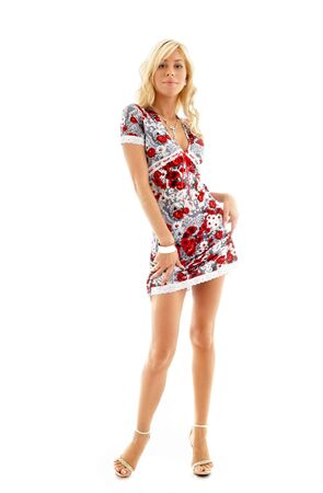 classical pin-up image of lovely blond in colorful dress photo