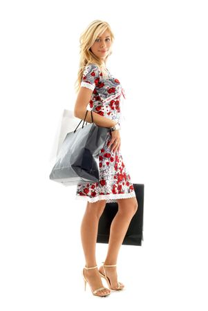 lovely blond with shopping bags over white photo