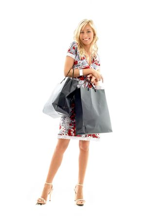 lovely blond with shopping bags over white Stock Photo