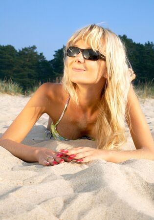 portrait of happy blond relaxing at the beach Stock Photo - 610111