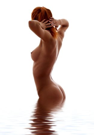 aqua naked: classical silhouette image of fit girl standing in water