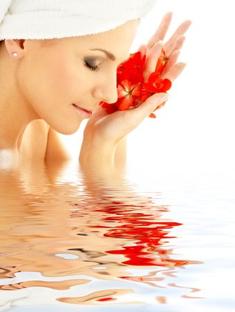 lovely woman with red flower petals in water Stock Photo - 616451
