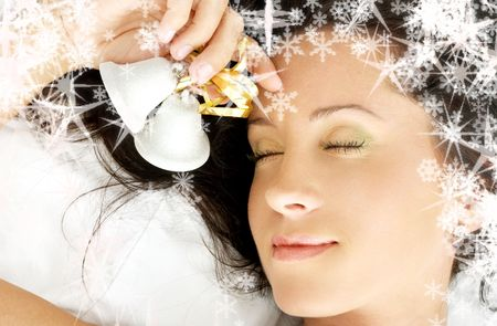 christmas bells: dreaming girl with christmas bells and rendered snowflakes