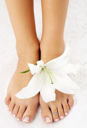 beautiful lady feet with madonna lily in spa photo