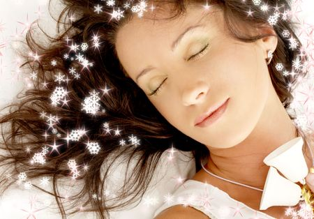 dreaming girl with christmas bells surrounded by rendered snowflakes Stock Photo - 636877