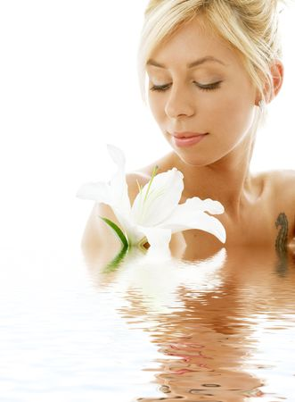pretty lady with madonna lily in water Stock Photo - 634373