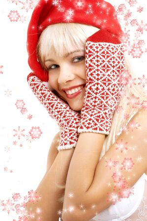 pretty girl in santa helper hat surrounded by rendered snowflakes photo