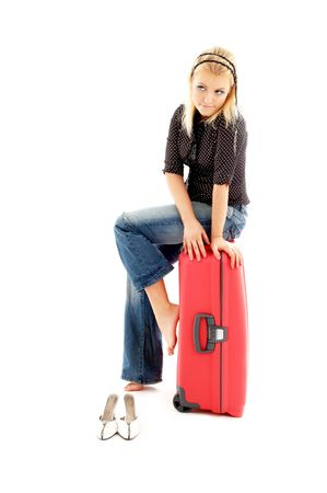 blond girl sitting on red trunk over white photo