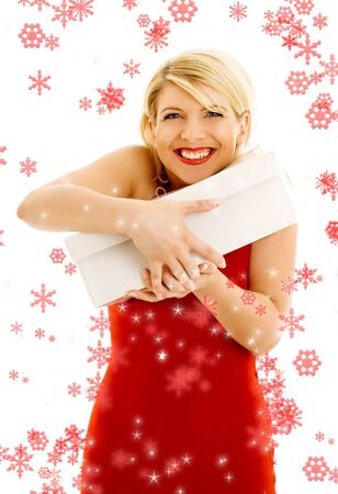 Happy thankful girl holding white box surrounded by rendered snowflakes photo
