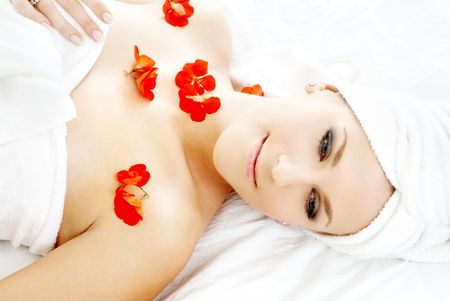 beautiful lady with red flower petals in spa Stock Photo - 656431