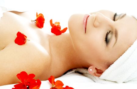 beautiful lady with red flower petals in spa Stock Photo - 656448
