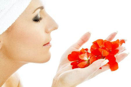 lovely woman with red flower petals in spa Stock Photo - 658412
