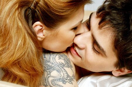 picture of sweet couple cuddling in bed Stock Photo - 671719