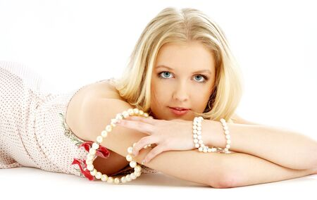 laying blond in pink dress with pearls over white Stock Photo - 671725