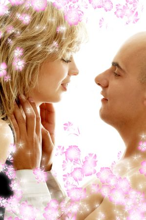liaison: intimate picture of sweet couple surrounded by rendered flowers Stock Photo