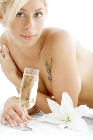 lovely topless girl with champagne glass and madonna lily Stock Photo - 680354