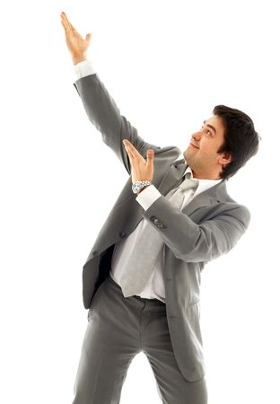 energetic businessman showing imaginary product over white photo