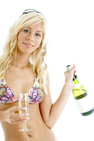 lovely blond in colorful bikini holding glass and bottle of wine Stock Photo - 688710