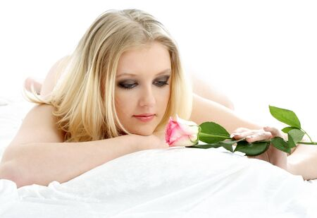 picture of lovely blond with rose laying in bed Stock Photo - 688706