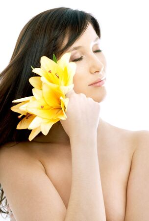 topless brunette: topless brunette with yellow lily flowers in spa