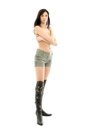 topless brunette in green shorts and boots over white Stock Photo - 699160
