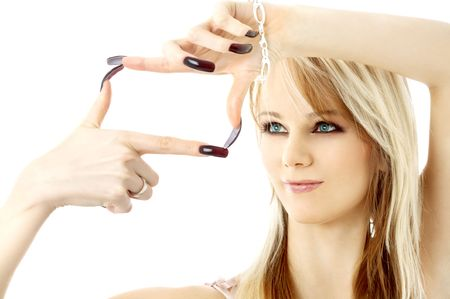 blond with long nails looking through her fingers in a box shape Stock Photo - 707179