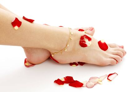 feet of lady relaxing in spa on white Stock Photo - 711603