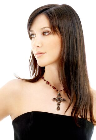 portrait of lovely brunette with crucifix over white photo