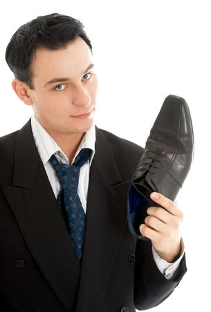 picture of salesman with black leather boot over white photo