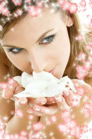 remedial: lovely woman in spa smelling white rose petals surrounded by rendered flowers