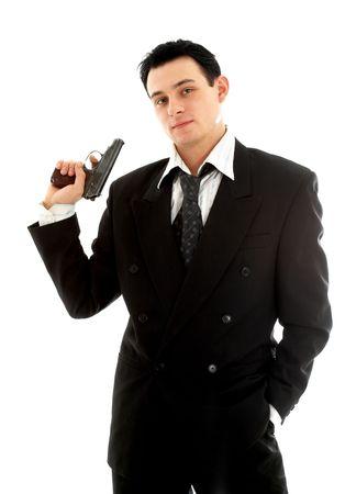 venganza: Hombre con una pistola sobre fondo blanco  Foto de archivo