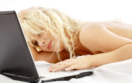 portrait of blond laying in bed with laptop computer Stock Photo - 720097