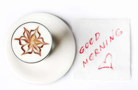 barista latte coffee glass with good morning note on tissue photo